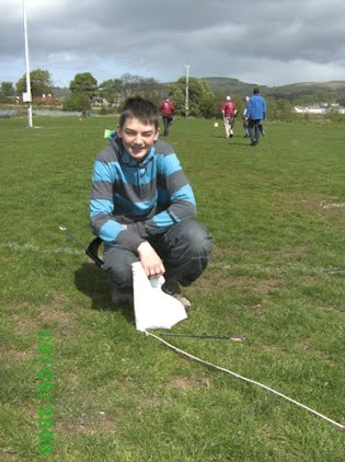 Connor with perfect five point arrow located at base of flag