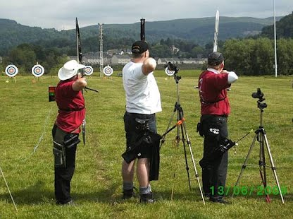 Shooting line archers taking aim at targets