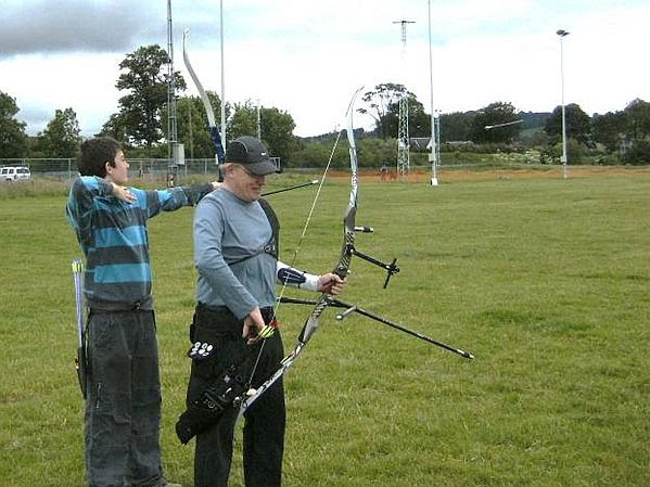 Connor and Tim at the shooting line